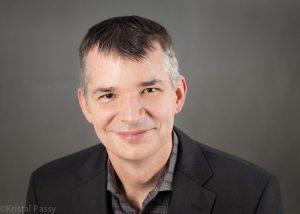 Headshot of Destin Ferdun, NHA's Director of Real Estate Development