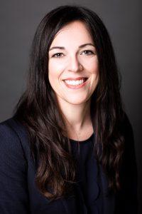 Professional headshot of Desi Bellamy