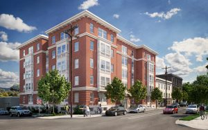 An architectural rendering of the Susan Emmons building, a five story brick affordable housing development in Portland's NW neighborhood.