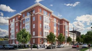 Architectural rendering of the future Susan Emmons affordable housing project featuring a five-story brick building