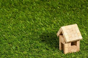 small house made of blocks sitting on the grass